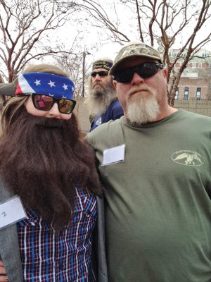 Mary Kate Denis, 17, of Jacksonville, left, aka Willie Robertson, winner of a Duck Commander celebration held in Monroe, La., poses with another contestant portraying Duck Dynasty star John Godwin.