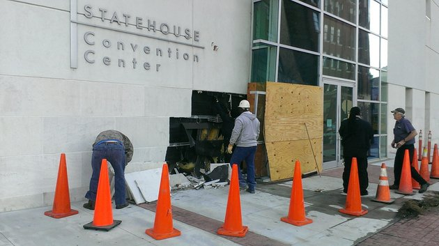 workers-assess-the-damage-to-the-statehouse-convention-center-in-little-rock-after-a-driver-crashed-into-the-building-friday-dec-27-2013