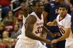 Arkansas' Moses Kingsley runs to defend against South Alabama's Aakim Saintil as he receives the ball during their game at Verizon Arena December 21, 2013.