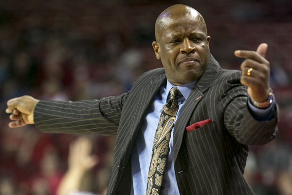 Arkansas coach Mike Anderson signals for players on the bench during the second half of an NCAA college basketball game against High Point on Saturday, Dec. 28, 2013, in Fayetteville, Ark. Arkansas defeated High Point 89-48. (AP Photo/Gareth Patterson)