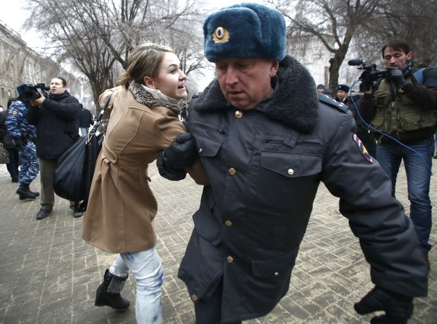 police-officers-detain-people-who-gathered-for-an-unsanctioned-event-in-downtown-volgograd-russia-on-monday-dec-30-2013-volgograd-is-about-400-miles-northeast-of-sochi-where-the-olympics-are-to-be-held