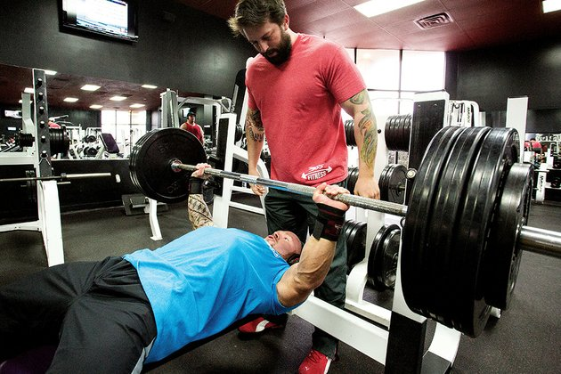 phillip-brewer-benchpresses-at-365-fitness-in-conway-while-facility-co-owner-anthony-sacomani-spots-for-him