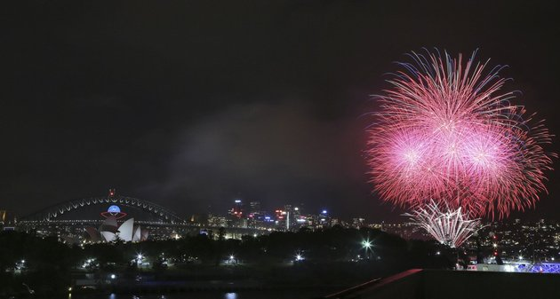 fireworks-explode-near-the-harbor-bridge-and-the-opera-house-during-new-years-eve-celebrations-in-sydney-australia-on-tuesday-dec-31-2013