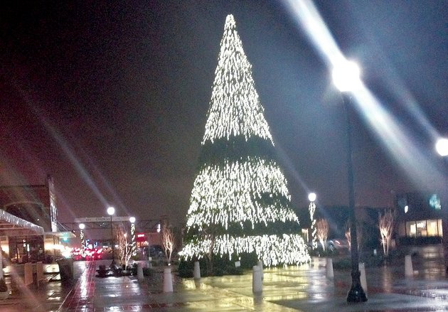 at-54-feet-the-artificial-christmas-tree-in-downtown-conway-is-said-to-be-among-the-larger-ones-in-the-region-get-lit-of-springdale-installed-the-tree-but-company-representatives-have-had-to-make-return-trips-to-fix-a-variety-of-problems