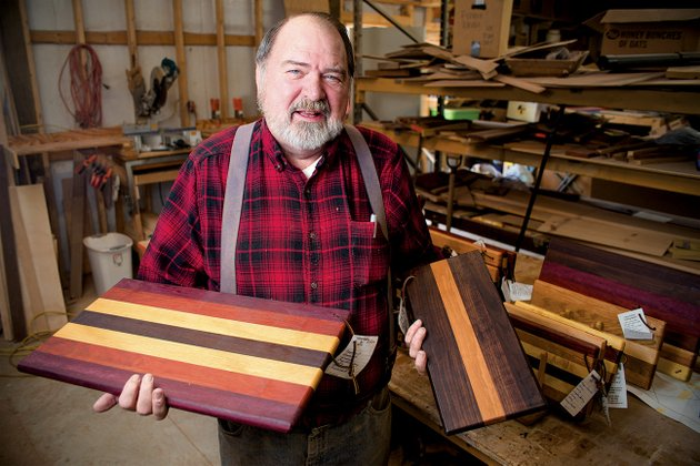 richard-white-of-beebe-holds-samples-of-the-cutting-boards-he-makes-from-domestic-and-exotic-hardwoods