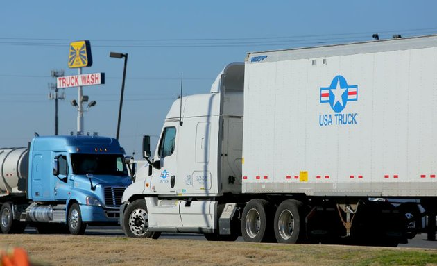 a-usa-truck-tractor-trailer-idles-in-a-parking-area-at-a-north-little-rock-truck-stop-tuesday-usa-trucks-value-more-than-tripled-last-year