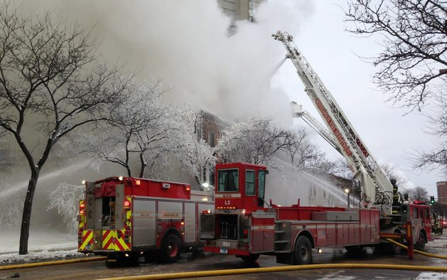 firefighters-work-the-scene-where-a-fire-engulfed-several-apartment-units-in-the-cedar-riverside-neighborhood-in-minneapolis-on-wednesday-authorities-say-at-least-13-people-have-been-hurt