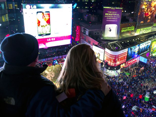 kenn-magowan-left-anna-edgerly-moore-both-of-new-york-look-out-over-times-square-wednesday-jan-1-2014-as-the-new-year-is-celebrated