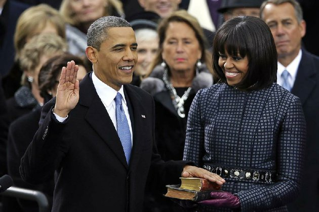 president-barack-obama-received-the-oath-of-office-while-first-lady-michelle-obama-received-a-stamp-of-approval-for-her-bangs