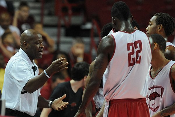 Arkansas coach Mike Anderson speaks to members of the white squad during the first half of play in the Red-White game Sunday, Oct. 27, 2013, in Bud Walton Arena in Fayetteville.
