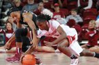 Arkansas' Keira Peak, right, and South Carolina's Tiffany Mitchell dive for a loose ball Thursday, Jan. 2, 2014, during the second half of the game at Bud Walton Arena in Fayetteville.