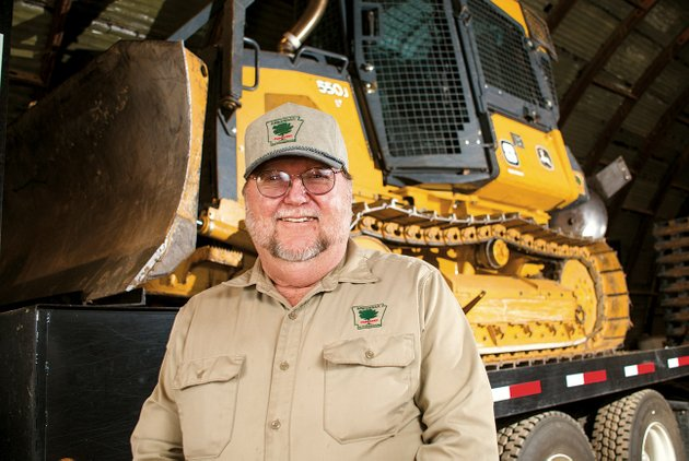 danny-crumley-of-batesville-was-recently-named-the-district-8-employee-of-the-year-by-the-arkansas-forestry-commission-the-plow-equipped-bulldozer-in-the-background-is-one-of-the-tools-crumley-and-the-commission-use-to-fight-fires-crumley-is-in-his-15th-year-as-a-forester