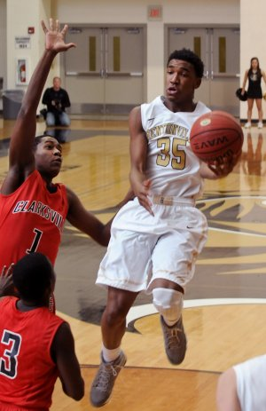 Bentonville's Malik Monk attempts a shot while being guarded by Clarksville's Jarren Thompson during the basketball game in Bentonville's Tiger Arena on Tuesday November 26, 2013.