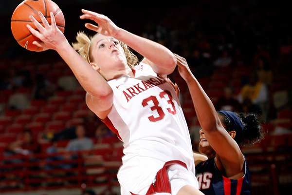 Melissa Wolff scored 14 points and recorded 12 rebounds in her first start at Missouri on Sunday. The Razorbacks won 69-66.