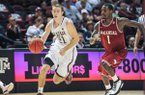Texas A&M guard Alex Caruso drives past Arkansas defender Mardracus Wade at Reed Arena on Jan. 9, 2013. The Aggies defeated the Razorbacks 69-51 in the conference opener last year.