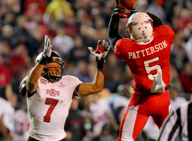 ball-state-universitys-eric-patterson-5-nearly-intercepts-a-pass-in-front-of-arkansas-states-julian-jones-during-the-first-half-godaddy-bowl-on-sunday-at-ladd-peebles-stadium-in-mobile-ala