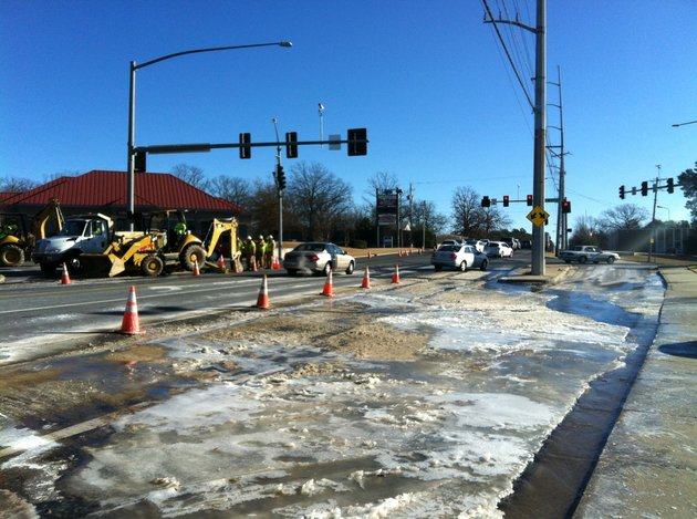 a-mix-of-ice-and-slush-develops-monday-dec-6-2014-from-an-underground-water-pipe-leak-at-the-intersection-of-west-markham-street-and-rodney-parham-road-in-little-rock