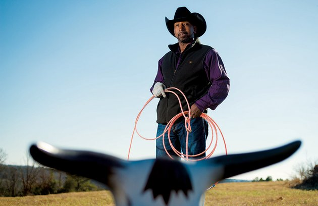 cowboy-wefus-tyus-of-twin-groves-uses-a-roping-dummy-for-practice