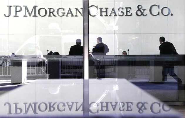 people-stand-in-the-lobby-of-jpmorgan-chase-headquarters-in-new-york-in-this-may-11-2012-file-photo