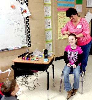 Submitted Photo Nedra Engleman chose this second grader to demonstrate how a beautician creates a hair style.