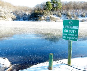 Photo by Randy Moll With temperatures just below zero on Monday morning, ice covered most of Crystal Lake in Decatur following freezing rain, sleet and snow on Sunday morning. Snow and ice also covered roadways, making travel treacherous.