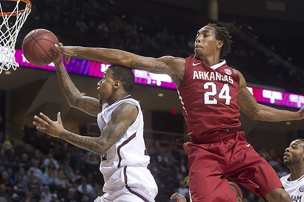 Arkansas' Michael Qualls (24) knocks the ball away from Texas A&M's Fabyon Harris during the first half of an NCAA college basketball game in College Station, Texas, Wednesday, Jan. 8, 2014. (AP Photo/Bryan College Station Eagle, Stuart Villanueva)