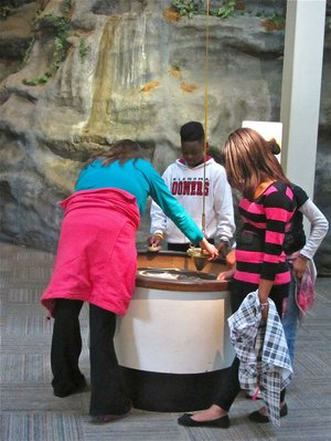 Visitors to Hot Springs' Mid-America Science Museum experiment with the facility's Sand Pendulum.