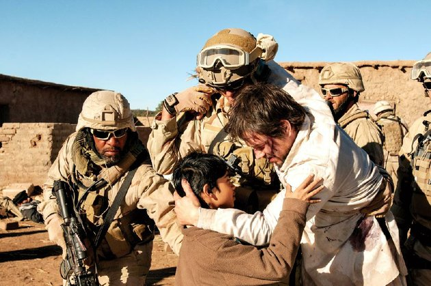 l-to-r-foreground-gulabs-young-son-rohan-chand-is-embraced-by-marcus-luttrell-mark-wahlberg-in-lone-survivor-the-incredible-story-of-four-navy-seals-on-a-covert-mission-to-neutralize-a-high-level-taliban-operative-who-are-ambushed-by-enemy-forces-in-the-mountains-of-afghanistan-the-film-is-based-on-the-new-york-times-bestselling-tale-of-heroism-courage-and-survival