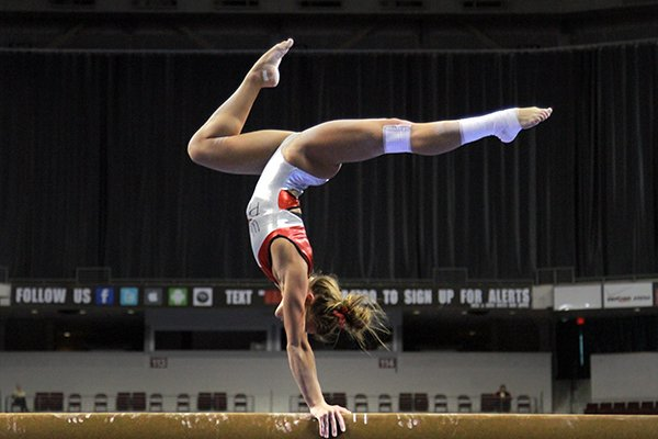 Arkansas gymnast Katherine Grable warms up on the balance beam during a practice session with teammates Friday at Verizon Arena in North Little Rock in preparation for Saturday's SEC Gymnastics championships.
