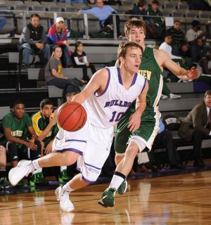 Fayetteville senior Luke Renner, left, drives past Springfield (Mo.) Parkview guard Autry Acord during the first half of play Monday, Nov. 25, 2013, at Bulldog Arena in Fayetteville. Visit photos.nwaonline.com for more photographs from the game.