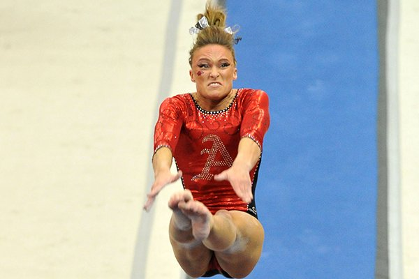 University of Arkansas gymnast Katherine Grable makes her vault attempt during Friday night's gymnastics meet at Barnhill Arena in Fayetteville.