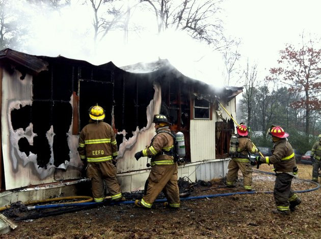 fire-officials-work-friday-jan-10-2014-to-extinguish-a-blaze-at-2921-juarez-drive-in-pulaski-county