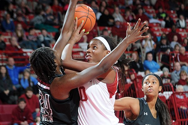 Arkansas' Jessica Jackson, right, runs through South Carolina's Aleighsa Welch Thursday, Jan. 2, 2014, during the second half of the game at Bud Walton Arena in Fayetteville.