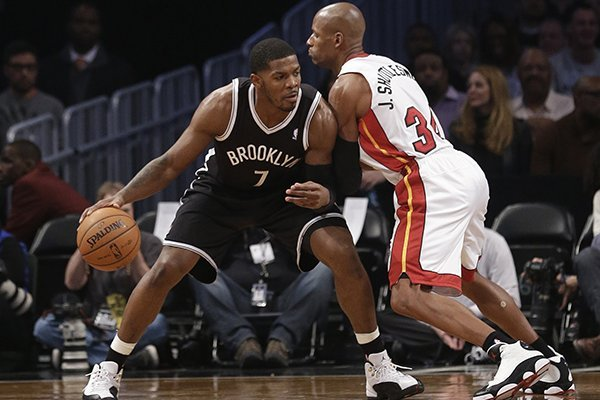Brooklyn Nets' Joe Johnson (7) is defended by Miami Heat's Ray Allen (34) during the first half of an NBA basketball game on Friday, Jan. 10, 2014, in New York. (AP Photo/Frank Franklin II)