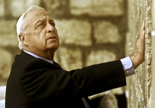 in-this-wednesday-feb-7-2001-file-photo-ariel-sharon-then-israels-prime-minister-elect-looks-up-as-he-touches-judaism-holiest-site-the-western-wall-in-jerusalem-the-son-of-former-israeli-prime-minister-ariel-sharon-says-his-father-has-died-on-saturday-jan-11-2014-the-85-year-old-sharon-had-been-in-a-coma-since-a-debilitating-stroke-eight-years-ago-ap-photodavid-guttenfelder-file