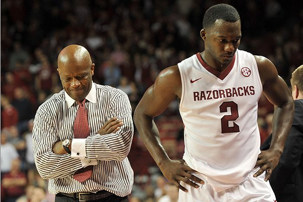 Arkansas coach Mike Anderson and Arkansas forward Alandise Harris talk on the sidelines after Arkansas turned the ball over late in the overtime period of Saturday afternoon's game against Florida at Bud Walton Arena in Fayetteville.