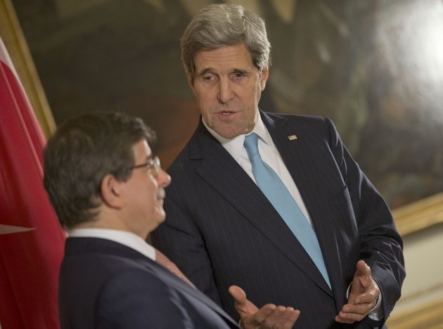 us-secretary-of-state-john-kerry-right-speaks-with-turkish-foreign-minister-ahmet-davutoglu-left-at-the-us-ambassador-residence-in-paris-france-sunday-jan-12-2014-kerry-is-in-paris-to-attend-a-two-day-meeting-on-syria-to-rally-international-support-for-ending-the-three-year-civil-war-in-syria-ap-photopablo-martinez-monsivais-pool