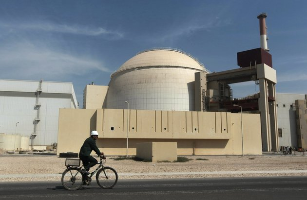 in-this-oct-26-2010-file-photo-a-worker-rides-a-bicycle-in-front-of-the-reactor-building-of-the-bushehr-nuclear-power-plant-just-outside-the-southern-city-of-bushehr-iran-and-six-world-powers-have-agreed-on-how-to-implement-a-nuclear-deal-struck-in-november-with-its-terms-starting-from-jan-20-officials-announced-sunday-ap-photomehr-news-agency-majid-asgaripour-file