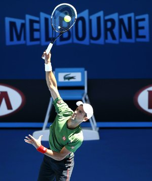Novak Djokovic of Serbia serves during a training session ahead of the Australian Open tennis championship in Melbourne, Australia, Sunday, Jan. 12, 2014. (AP Photo/Eugene Hoshiko)