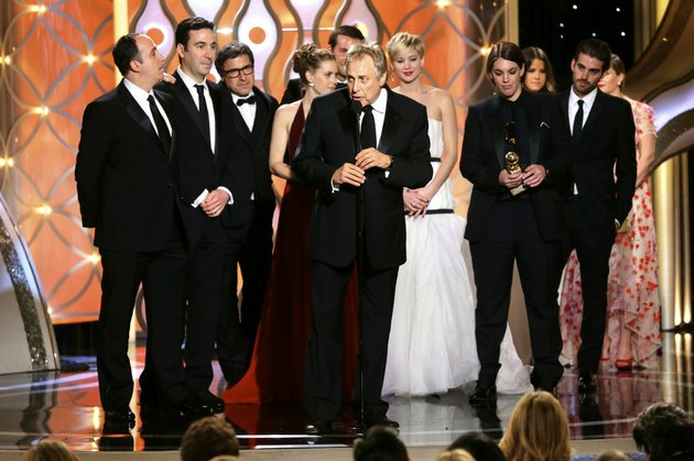 this-image-released-by-nbc-shows-charles-roven-center-accepting-the-award-for-best-motion-picture-comedy-for-american-hustle-during-the-71st-annual-golden-globe-awards-at-the-beverly-hilton-hotel-on-sunday-jan-12-2014-in-beverly-hills-calif