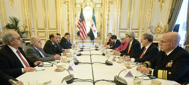 us-secretary-of-state-john-kerry-third-right-from-front-and-syrian-national-coalition-chief-ahmad-al-jarba-third-left-from-front-and-members-of-their-delegations-sit-at-the-start-of-their-meeting-at-the-us-ambassador-residence-in-paris-on-monday-jan-13-2014