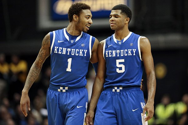 Kentucky's James Young (1) and Andrew Harrison (5) talk in the final minutes of an NCAA college basketball game against Vanderbilt on Saturday, Jan. 11, 2014, in Nashville, Tenn. Kentucky won 71-62. (AP Photo/Mark Humphrey)
