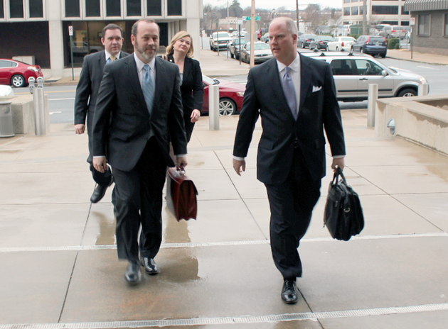 arkansas-attorney-general-dustin-mcdaniel-right-and-staff-members-arrive-monday-jan-13-2014-at-a-fairness-hearing-over-an-agreement-to-phase-out-millions-in-annual-desegregation-aid-paid-by-the-state-to-three-pulaski-county-school-districts