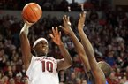 Arkansas forward Bobby Portis pulls up for a jump shot over Florida defender Dorian-Finney-Smith during the second half of Saturday afternoon's game at Bud Walton Arena in Fayetteville.