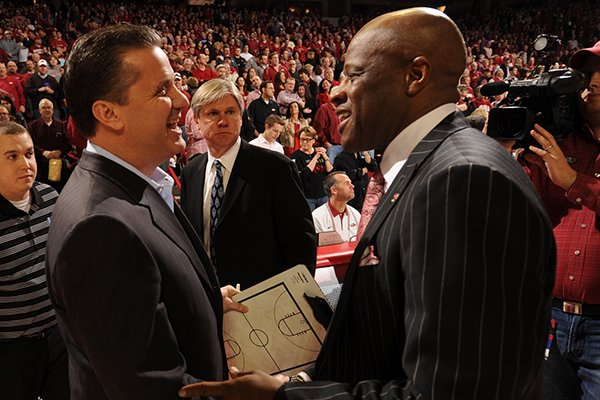 Kentucky coach John Calipari, left, and Arkansas coach Mike Anderson shake hands prior to a March 2, 2013 game at Bud Walton Arena in Fayetteville.
