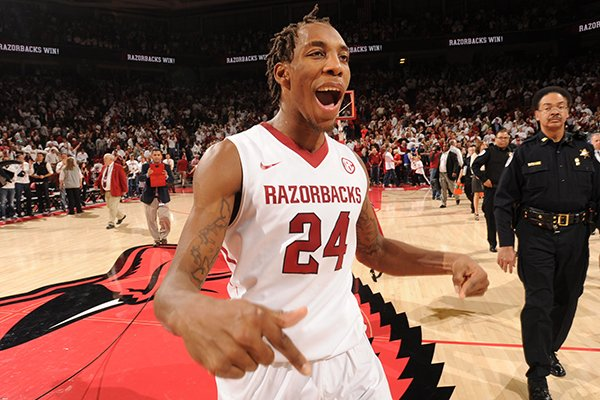 Michael Qualls celebrates following Arkansas' 87-85 overtime win over No. 13 Kentucky on Thursday at Bud Walton Arena in Fayetteville.