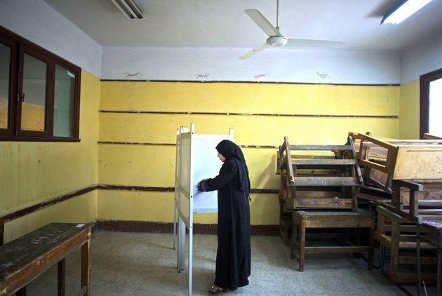 an-egyptian-woman-votes-in-the-countrys-constitutional-referendum-in-cairo-on-tuesday-jan-14-2014-military-helicopters-buzzed-overhead-and-hundreds-of-thousands-of-soldiers-and-police-were-deployed-as-egyptians-voted-tuesday-on-a-new-constitution-in-a-referendum-that-will-pave-the-way-for-a-likely-presidential-run-by-the-nations-top-general-months-after-he-ousted-islamist-president-mohammed-morsi