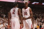 Arkansas forward Alandise Harris, left, celebrates with forward Bobby Portis (10) after Harris scored a basket in the closing moments of the second half of play Tuesday, Jan. 14, 2014, in Bud Walton Arena in Fayetteville.