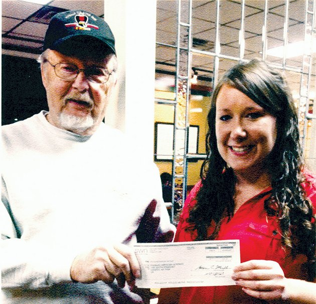 dave-hellerich-of-conway-adjutant-of-the-john-h-dunn-disabled-american-veterans-chapter-10-accepts-a-check-for-2000-from-tabitha-scott-an-employee-of-southwestern-energy-hellerich-said-the-money-from-the-community-heroes-program-will-be-put-toward-a-project-to-connect-the-dav-buildings-septic-system-to-the-citys-sewer-line
