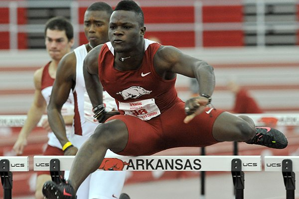 Arkansas hurdler Omar McLeod clears a hurdle as he pulls ahead to win the men's 60 meter hurdles event in the Arkansas Invitational indoor track meet Friday afternoon at the Randal Tyson Track Complex in Fayetteville.